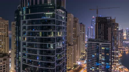 ОАЭ : Night illumination of Dubai Marina aerial timelapse, UAE.
