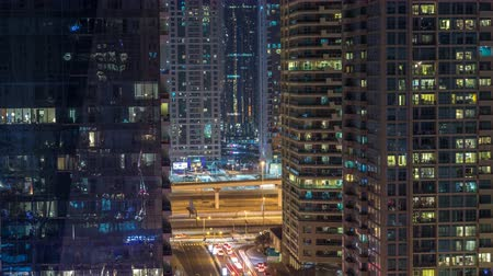 estrutural : Water canal on Dubai Marina skyline at night timelapse.