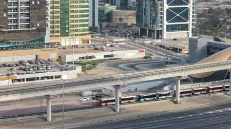 tramvaj : Aerial view of Metro station near Jumeirah lakes towers skyscrapers timelapse with traffic on sheikh zayed road.