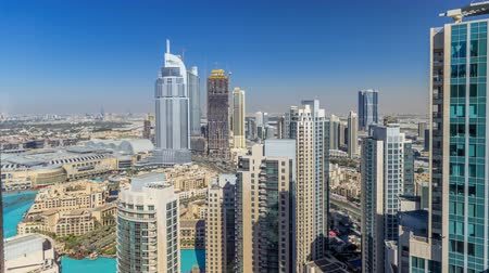 недвижимость : Dubai downtown during all day timelapse
