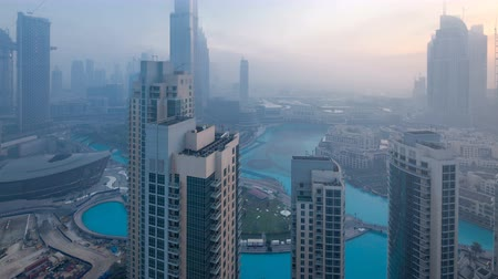 bank tower : Foggy morning in downtown of Dubai night to day timelapse.