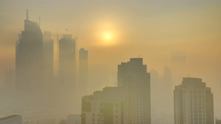 altitude : Foggy morning sunrise in downtown of Dubai timelapse.