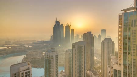 impressive skyline : Foggy morning sunrise in downtown of Dubai timelapse.