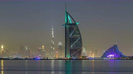 khalifa : Skyline of Dubai by night with Burj Al Arab from the Palm Jumeirah timelapse hyperlapse. Stock Footage