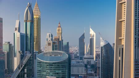 properties : Skyline view of the buildings of Sheikh Zayed Road and DIFC timelapse in Dubai, UAE.