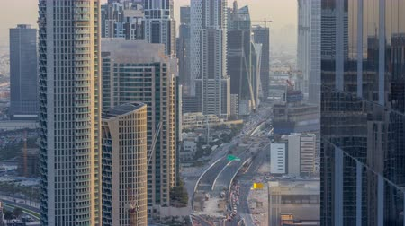 passagem elevada : Dubai Downtown evening timelapse modern towers view from the top in Dubai, United Arab Emirates. Vídeos