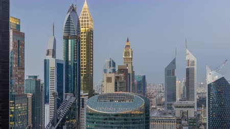properties : Skyline view of the buildings of Sheikh Zayed Road and DIFC day to night timelapse in Dubai, UAE.