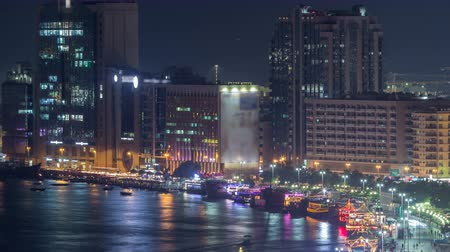 water taxi : Dubai creek landscape night timelapse with boats and ship near waterfront