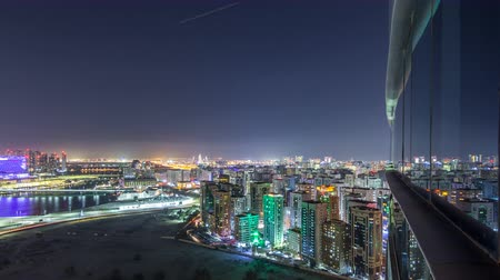 corniche : Aerial skyline of Abu Dhabi city centre from above night timelapse