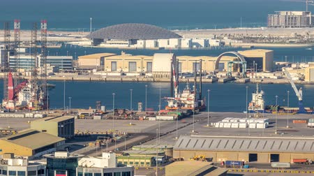 docking : Big cargo ship at industrial port timelapse aerial fiew from above at evening in Abu Dhabi