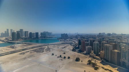 binário : Aerial skyline of Abu Dhabi city centre from above during all day timelapse