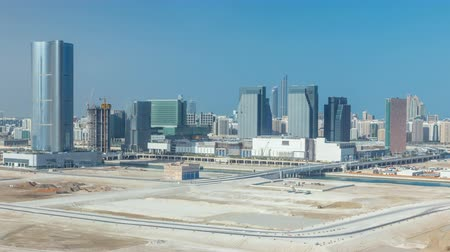 dredging : Buildings on Al Reem island in Abu Dhabi timelapse from above.