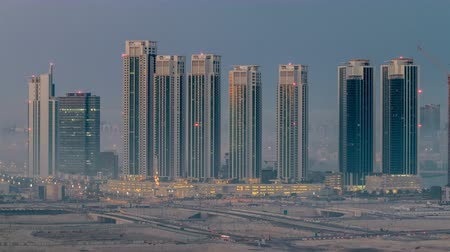 dredging : Buildings on Al Reem island in Abu Dhabi night to day timelapse from above. Stock Footage