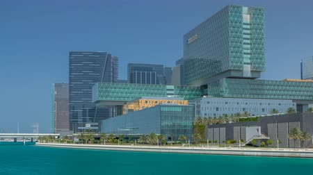 linha de costa : Modern buildings in Abu Dhabi skyline timelapse with mall and beach. Vídeos