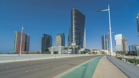 segmento : Modern buildings in Abu Dhabi skyline timelapse hyperlapse with waterfront.