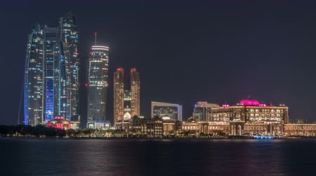 штаб квартира : Skyscrapers of Abu Dhabi at night with Etihad Towers buildings timelapse.