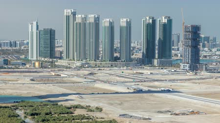 gyertyafa : Buildings on Al Reem island in Abu Dhabi timelapse from above.