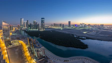 dredging : Buildings on Al Reem island in Abu Dhabi day to night timelapse from above. Stock Footage