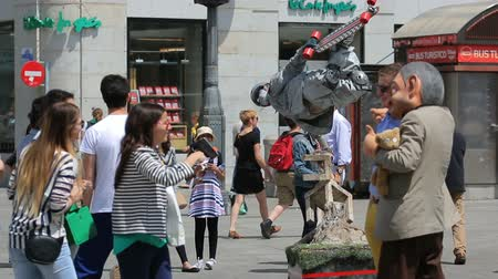 busking : Mimes on square Puerta del Sol entertain public in Madrid, Spain