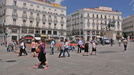real madrid : People walk on the Puerta del Sol square near the fountain in Madrid, Spain Stock Footage