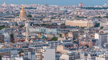 akşam : Aerial panorama above houses rooftops in a Paris day to night timelapse Stok Video