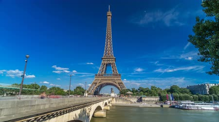 eifel : Eiffel Tower with bridge over Siene river in Paris timelapse hyperlapse, France Stock Footage