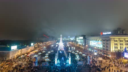 golden time : Firework above Christmas tree timelapse, Kharkov, Ukraine.