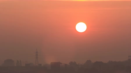 pilon : Sunrise at city with high-voltage power transmission line timelapse Stock mozgókép
