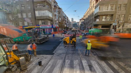 obnova : Tractor, roller on the road repair site timelapse. Road construction equipment.