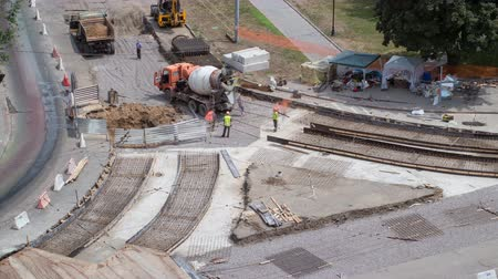 paving : Concrete works for road maintenance construction with many workers and mixer timelapse