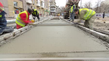 reinforced concrete : Pouring ready-mixed concrete after placing steel reinforcement to make the road by concrete mixer timelapse hyperlapse.