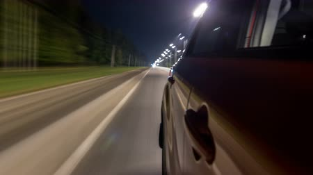 perspective : Drivelapse from Side of Car moving on a night highway timelapse hyperlapse Stock Footage