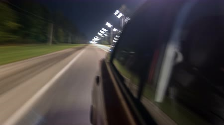 speedway : Drivelapse from Side of Car moving on a night highway timelapse hyperlapse Stock Footage