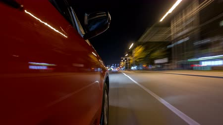 speedway : Drivelapse from side of car moving on a night avenue in city timelapse hyperlapse