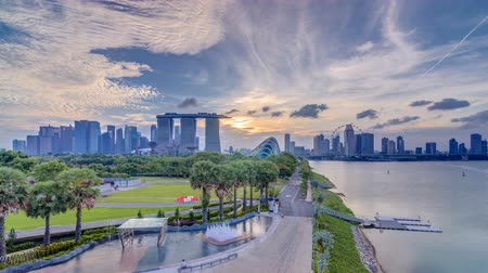 night singapore : Marina Bay Sands, Gardens by the bay with cloud forest, flower dome and supertrees at sunset timelapse