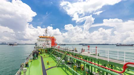construction crane : Green deck of the tanker under blue sky timelapse
