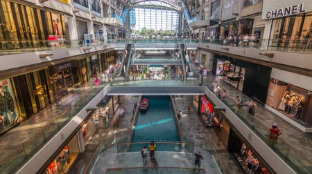 fashion outlet : Interior of The Shoppes at Marina Bay Sands timelapse. Stock Footage