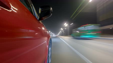 excesso de velocidade : Drivelapse urban look from fast driving car at a night avenue in a city timelapse hyperlapse Vídeos