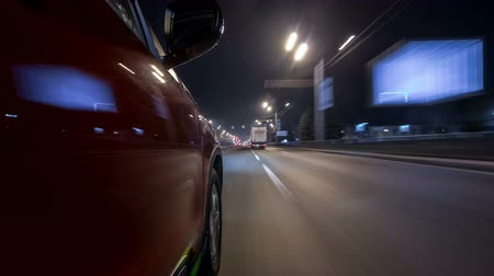 speedy : Drivelapse urban look from fast driving car at a night avenue in a city timelapse hyperlapse Stock Footage
