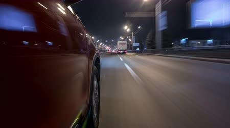 speedway : Drivelapse urban look from fast driving car at a night avenue in a city timelapse hyperlapse Stock Footage
