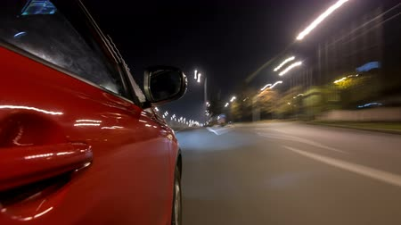příjezdová cesta : Drivelapse urban look from fast driving car at a night avenue in a city timelapse hyperlapse Dostupné videozáznamy