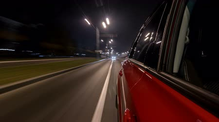 driveway : Drivelapse urban look from fast driving car at a night avenue in a city timelapse hyperlapse Stock Footage