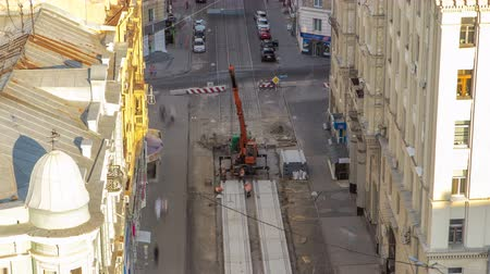 kladkostroj : Installing concrete plates by crane at road construction site timelapse.