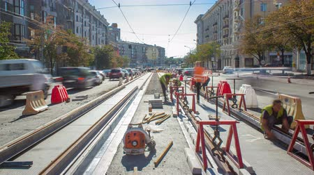 tramwaj : Tram rails at the stage of their installation and integration into concrete plates on the road timelapse.