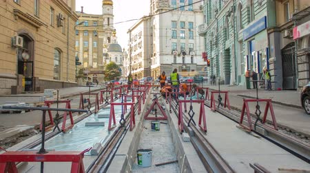 konumlandırma : Tram rails at the stage of their installation and integration into concrete plates on the road timelapse.