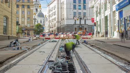 locomotion : Workers do cleaning of the railway tram line after construction works.
