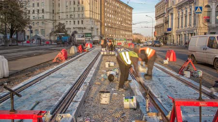 sleepers : Tram rails at the stage of their installation and integration into concrete plates on the road timelapse.