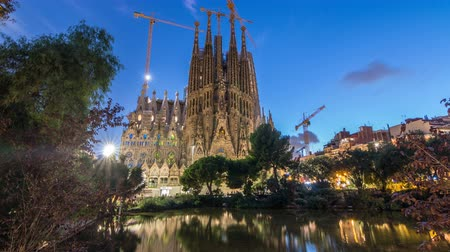 spanish style : Sagrada Familia, a large church in Barcelona, Spain day to night timelapse. Stock Footage