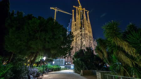 modernist : Sagrada Familia, a large church in Barcelona, Spain night timelapse hyperlapse.