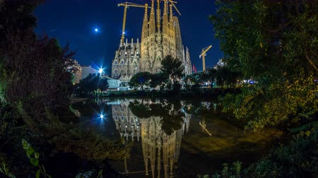 spanish style : Sagrada Familia, a large church in Barcelona, Spain night timelapse.